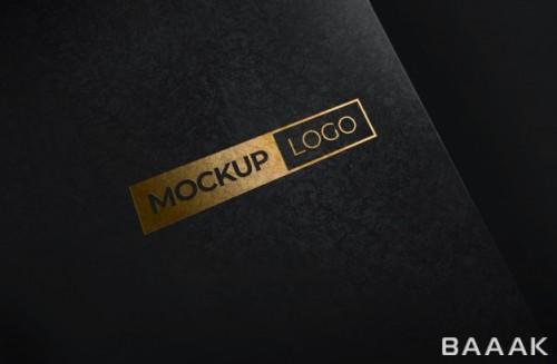 موکاپ لوگو طلایی روی کاغذ سیاه رنگ