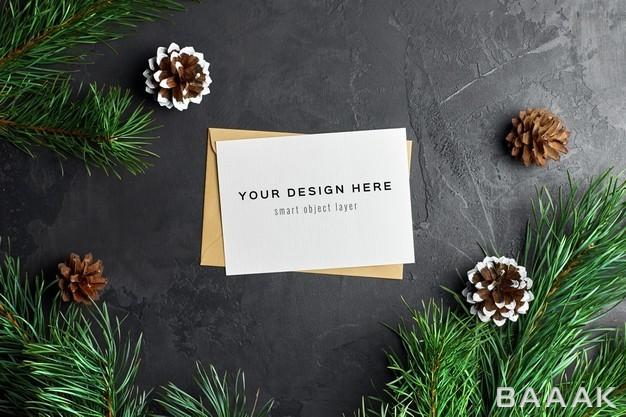موکاپ-کارت-تبریک-کریسمس-با-شاخه-های-درخت-کاج_864910440