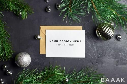 موکاپ کارت تبریک کریسمس با طراحی شاخه های درخت کاج
